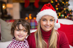 Festive mother and son smiling at camera Stock Photos