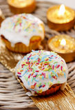 Festive muffins decorated with colorful sprinkles Royalty Free Stock Photos
