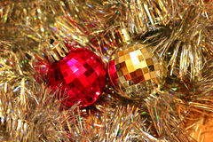 Festive multi-colored background with Christmas tinsel and balls Stock Image