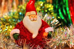 Festive multi-colored background with Christmas tinsel and Santa Claus Stock Images