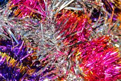 Festive multi-colored background with Christmas tinsel Royalty Free Stock Images