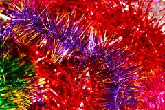 Festive multi-colored background with Christmas tinsel Stock Images
