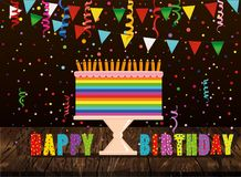 A festive multicolored and iridescent big cake with candles on a. Stand. Happy Birthday. Confetti and garland of flags. Greeting card or invitation for a Stock Images