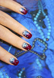 Festive nail design. Festive nail design for short nails on a blue background royalty free stock photo