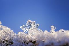 Festive natural background with a beautiful carved snowflake and stock photo