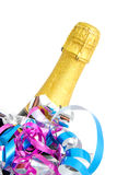 Festive neck of champagne bottle. Neck of closed champagne bottle packed in golden paper with colorful streamers over white background Stock Photography