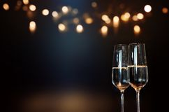 Festive new year with champagne. Festive new years wishes with champagne and golden bokeh Royalty Free Stock Images