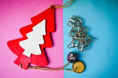 Festive New Year Christmas wooden and metal toy homemade tree and star. Flat lay. Top view. Holiday decorations royalty free stock photos