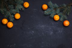 Festive new year composition with tangerines pine cones christmas tree. Festive new year composition with tangerines pine cones greens christmas tree Stock Photo