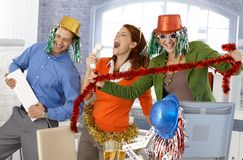 Festive new year office party. Office workers having fun with accessories Royalty Free Stock Image