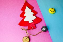 Festive New Year`s Christmas small toy wooden homemade tree and a round smiling emoticon. Flat lay. Top view. Holiday decorations. Festive New Year`s Christmas stock photography