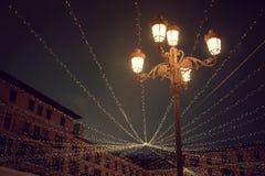 Festive night lighting. Decorative night lighting of a village celebration Stock Image