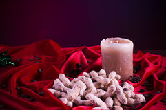 Festive nuts and candle Royalty Free Stock Photo