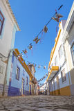 Festive old Portuguese street in the village of Ferragudo. Stock Photos
