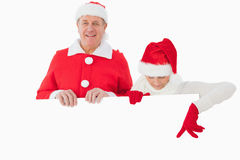 Festive older couple smiling and holding poster Stock Photos