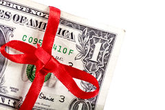 Festive one dollar. With a red bow across stock photography
