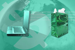 Festive online shopping. Computer with binary data projecting online shopping green festive gift bag Stock Photography