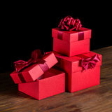 Festive opened boxes with bow on wooden background is , Stock Images
