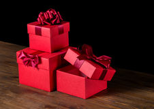 Festive opened boxes with bow on wooden background is isolated Stock Photo