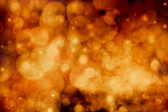 Festive orange bokeh background. Festive background. Christmas and New Year feast bokeh background with copyspace Stock Images