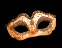 Festive orange / gold dress mask Royalty Free Stock Photo