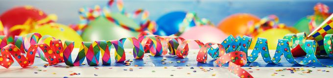 Festive party or carnival banner with balloons. Festive panorama party or carnival banner or header with colorful balloons, confetti and coiled streamers stock images