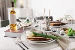 Festive Passover table setting with Torah at home. Pesach celebration stock image