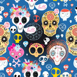Festive pattern of funny skulls. Bright festive pattern of funny skulls on blue background Royalty Free Stock Images