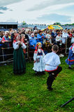 Festive people having fun and dancing, watching the performance on stage on the City Day in Veliky Novgorod, Russia Royalty Free Stock Image
