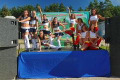 Festive performance of young beautiful girls of cheerleading athletes support group VERTIGO ( dizziness ). stock images