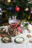A glass jar of homemade gingerbread cookies, cinnamon sticks and other decoration elements against a backgrou. A festive photo with a glass jar of homemade Royalty Free Stock Photos