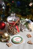 A glass jar of homemade gingerbread cookies, cinnamon sticks and other decoration elements against a backgrou. A festive photo with a glass jar of homemade Royalty Free Stock Images