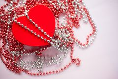 Gift box on the festive blurred background. Red heart. Valentine`s Day gift royalty free stock photo