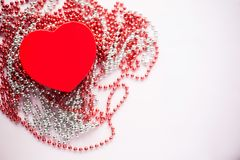 Gift box on the festive blurred background. Red heart. Valentine`s Day gift royalty free stock images