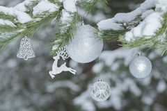Festive pine tree branches with shiny reindeer ornament and Christmas baubles at wood background Stock Photography