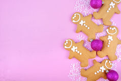 Festive pink theme Christmas holiday background with gingerbread Royalty Free Stock Photos