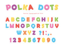 Festive polka dots font. Colorful ABC letters and numbers. Funny alphabet for kids. Isolated on white. Royalty Free Stock Photography