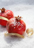 Festive pomegranates with ribbon Stock Photos
