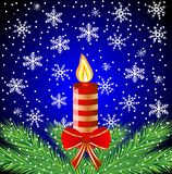 Festive postal with a candle and green branches Stock Images