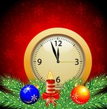 Festive postal with a clock, candle and green branches with toys Royalty Free Stock Images