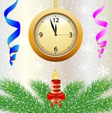 Festive postal with a clock, candle and green branches Stock Photo