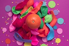 Festive poster balloons orange Confetti carnival background ultraviolet. Flat lay top view Royalty Free Stock Photography