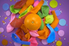 Festive poster balloons orange Confetti carnival background ultraviolet. Flat lay top view Stock Photos