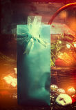 Festive present in blue box with ribbon over Christmas background Royalty Free Stock Photo