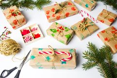 Festive presents boxes on a table. Festive packed presents boxes on a table top view Stock Images