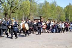 Festive procession. A festive procession of the village street Stock Photo