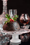 Festive Pudding. Festive Christmas pudding on comport decorated with holly and berries Stock Photo