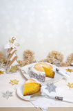 Festive pumpkin cake with coconut on table and Christmas decoration. Background bokeh Stock Images