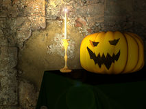 A festive pumpkin and a candle for Halloween Royalty Free Stock Photo