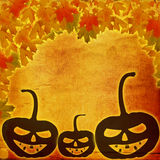 Festive pumpkin Halloween Day on the abstract paper background. With autumn leaves Royalty Free Stock Images
